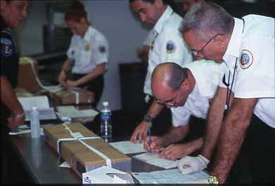 USDA packing turkey skins for shipment from the border to an approved taxidermy establishment.